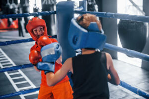 two kids training in a boxing class