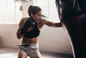 a woman hitting the punch bag